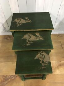 Green and gold hare-themed nesting tables