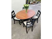 Vintage extendable dining table with 4 chairs in satin black and natural wood top.