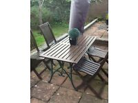 Garden table 4 chairs with wrought iron legs v g g