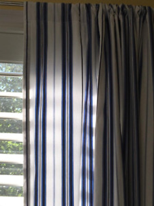 Pair of Pottery Barn lined cotton blue and white stripe curtains