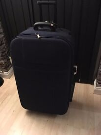 LARGE SUITCASE WITH WHEELS AND EXTENDING HANDLE