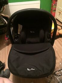 Selling silver cross car seat