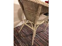 White wicker chair for garden or indoors