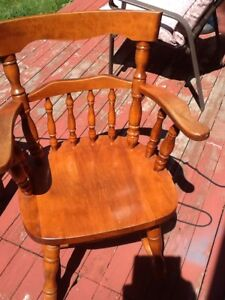 Wooden chair with arm rests