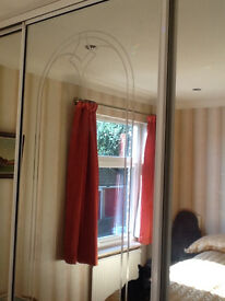 3 mirrored sliding wardrobe doors.