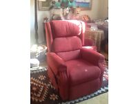 Reclining chair for sale - extremely comfortable red fabric chair with hand held electric controls