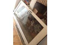 Double glazed external wood frame door £100.