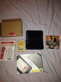 NINTENDO 3DS XL IN ORIGINAL BOX WITH STREET FIGHTER 4