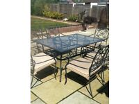 Wrought iron garden table & 6 chairs with cream cushions