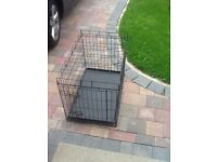 Medium dog cage for sale.