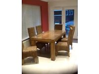 Mango wood table with 6 high backed sea grass chairs