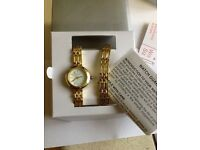 Spirit ladies gold tone watch & bracelet set