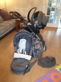 STOKKE SCOOT PRAM.. in great condition .with car seat and more extras