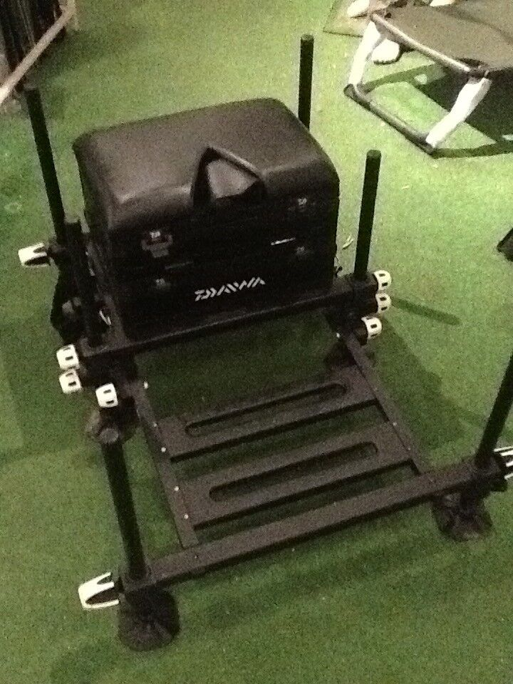 Diawa D75sb fishing seat box platformin Harpurhey, Manchester - Diawa D75SB fishing seat box and platform, height adjustable legs, very good condition, carry strap, make me an offer maybe a swap