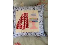 Hand appliqueed cushion for the 4 year old