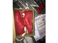 Red adidas unisex superstars size 6