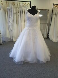 Affordable Plus size brand new wedding dresses. samples in sizes 20-30 starting from £150