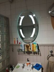 Light up mirror brand new boxed. Delivery can be arranged if required