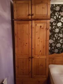 Two solid pine wardrobes £60 each or £100 for the pair. Very good condition.