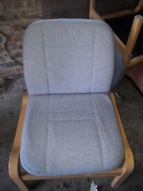 Comfortable chair and large carpet