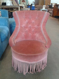 Tasselled lounge chair
