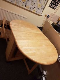 Small Kitchen table. Drop leaf table, wooden also comes with four chairs that match.