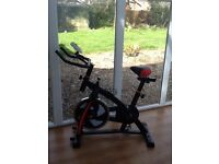 Flywheel excersise bike as new with heart rate monitor drinks holder etc