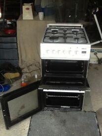 Beto double oven gas cooker . 500 mm wide by 600 mm deep x 900 mm high with built in splashback
