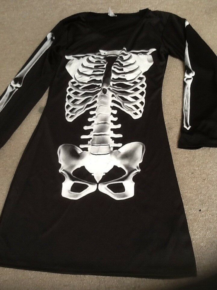 Size 8 Halloween dress with skeleton design