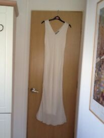 Ivory sleeveless dress covered with beads, fully lined. Size 8/10, never worn.