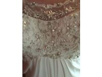 **Brand new with tags** Beautiful, heavily embellished ivory wedding gown/dress
