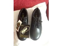 Occupational shoes size 8 black new with tags .
