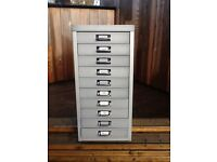 metal filing cabinet, in a light grey colour, for sale at £40.