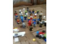 Original Lego figures and a few spare hats and tools