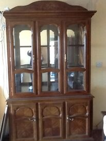 Large Display unit with cupboard under and light mirrored back glass doors