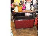 Vintage retro home cocktail bar, with burgandy padded frontage.