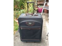 Large green nylon suitcase by antler with wheels