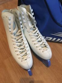 Ice skates, skate bag and blade guards