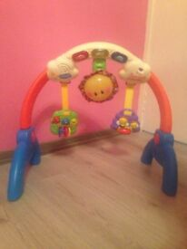 VTech Light-Up Rhyme Gym Baby Infant Musical Toy
