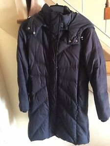 Fashionable and warm women's down filled coat, size Medium