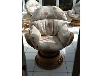 Four rattan swivel chairs and two rattan glass topped tables