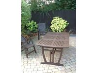 Large teak garden table and chairs