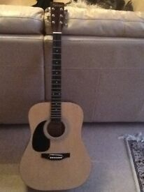 Falcon Left Handed Acoustic Guitar. In good condition.