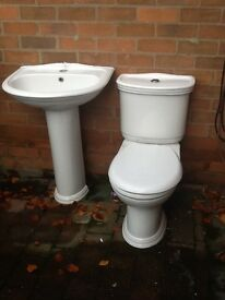 Close coupled w.c. With soft closing seat. One tap hole basin with pedastel