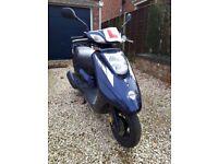 Navy blue Yamaha 125cc