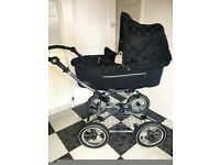 Black babystyle pram with carseat