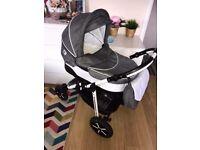 B&W Pram bundle. Carrycot,seat unit, car seat and matching bag.