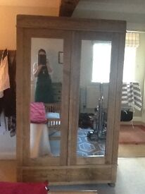 20th Century East European Pine wardrobe. Large, 2 mirrored doors. 2 drawers. Good looking.