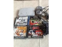 PlayStation 1 with games controllers and accessories