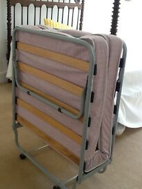 SIngle Foldaway Bed, Clean and Sturdy and Used by Child only a few times.